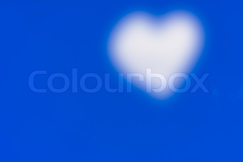 Blue sky and abstract heart cloud, stock photo