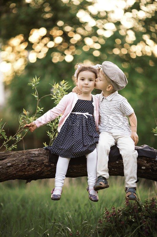Boy Kissing A Girl Stock Photo Colourbox