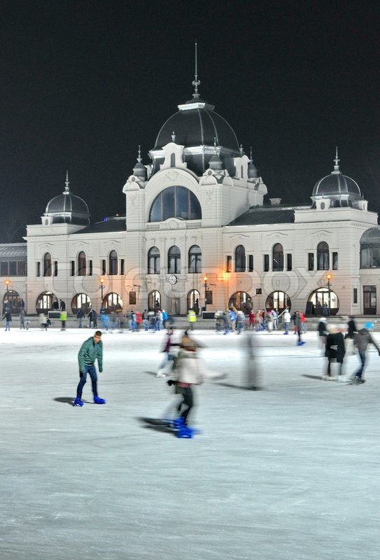 BUDAPEST - DECEMBER 13:Ice skaters in City Park Ice Rink on December 13, 2012 in Budapest, Hungary Opened in 1870, it is the largest and one of the oldest ice rinks in Europe, stock photo