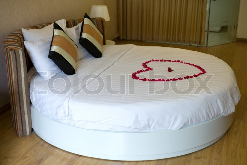 Honeymoon Bed Topped With Rose Petals