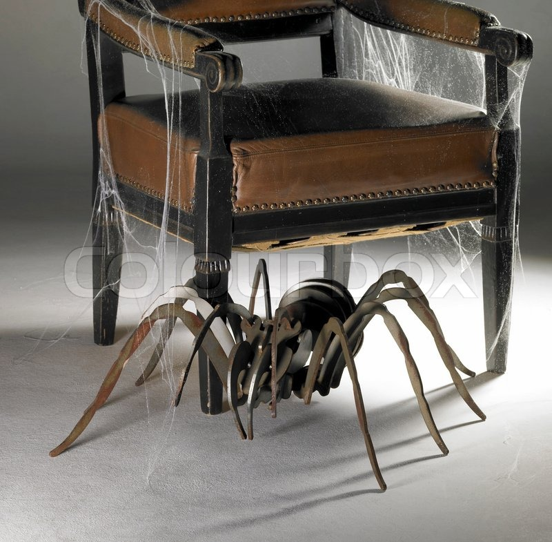 Winged chair and metallic spider | Stock Photo | Colourbox