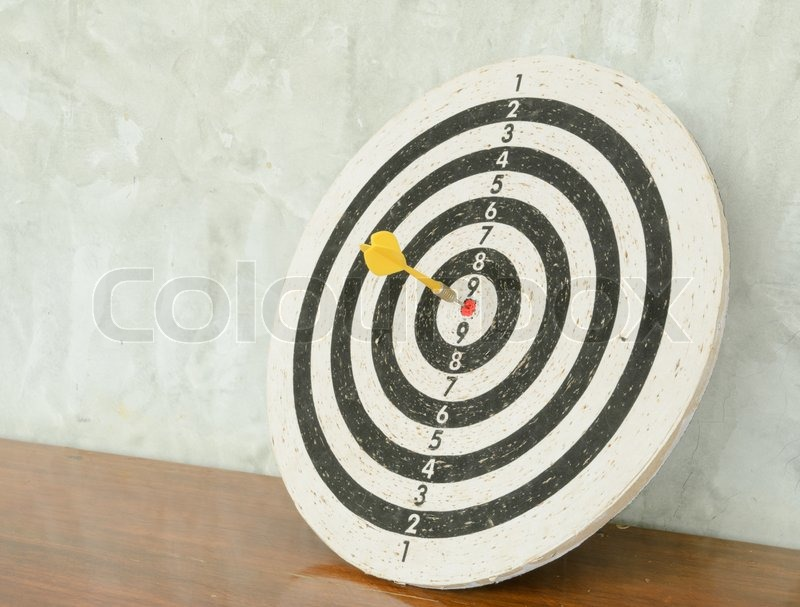 Stock image of 'Dart in dartboard'