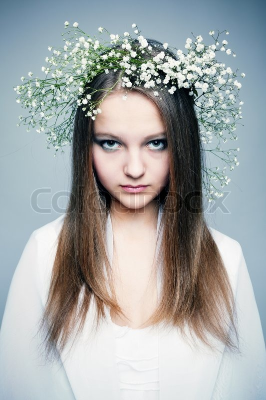 Spring portrait girl with wreath of flowers, stock photo