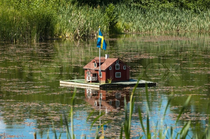 Small House In A Pond With Water Stock Photo Colourbox