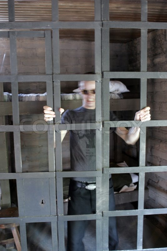 Stock image of 'A man inside a jail'