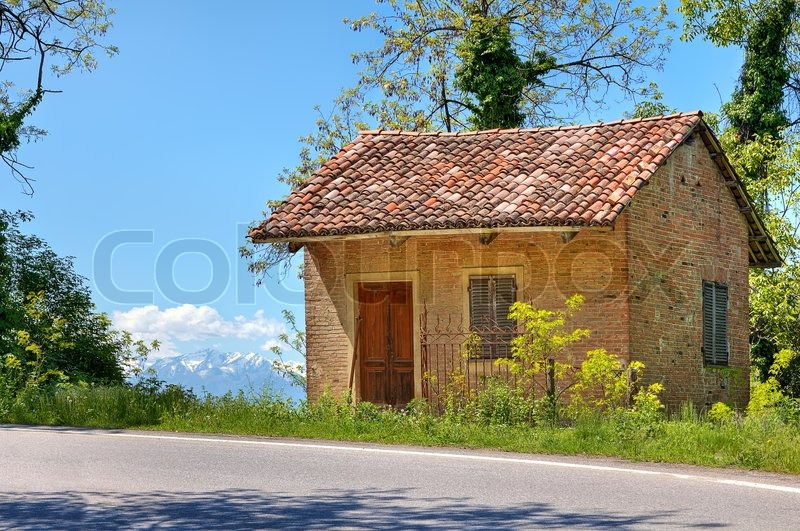 small rural brick house near road among trees in piedmont. Black Bedroom Furniture Sets. Home Design Ideas