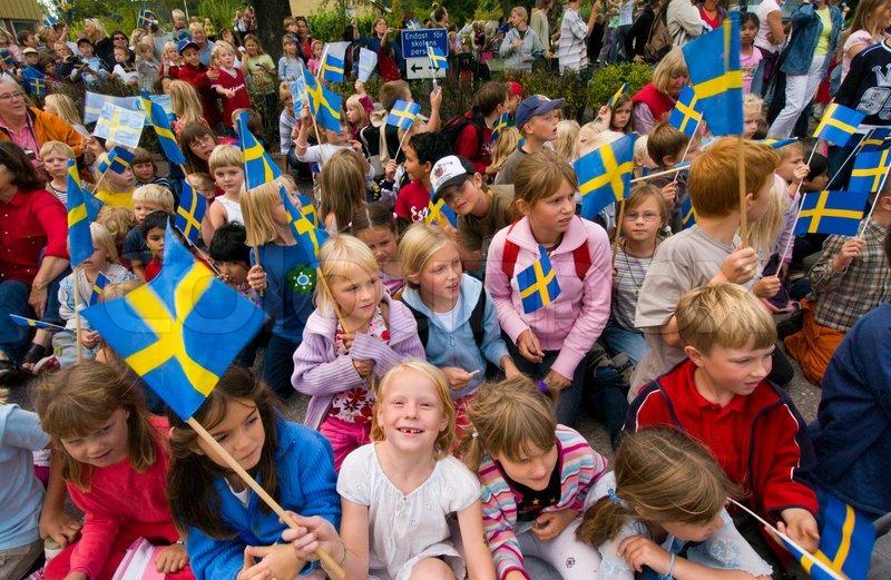 6058760-children-with-swedish-flags-sweden.jpg