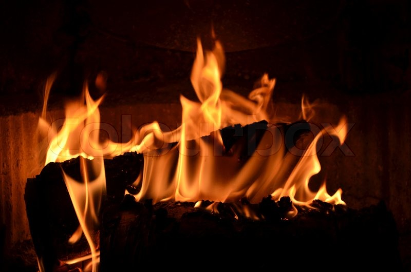Hot Burning Fire In The Fireplace With Birch Logs Stock Photo