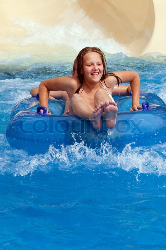 boy and girl on water slide | stock photo | colourbox