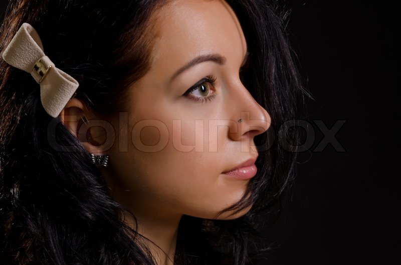 Stock image of 'Profile of a beautiful young woman'