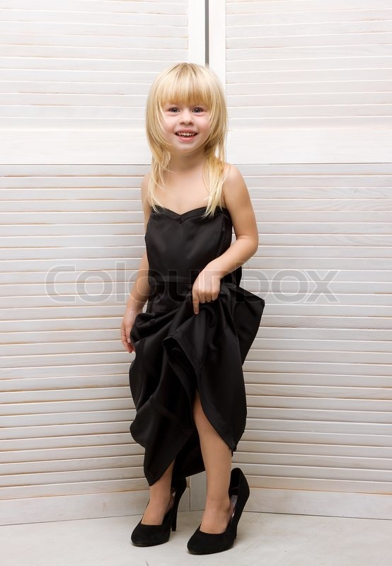 Girl 3 Years Old In Mother S Dress And High Heels Stock