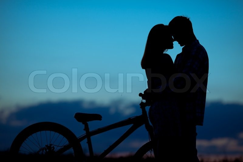 Sillhouette Of Sweet Young Couple In Stock Image