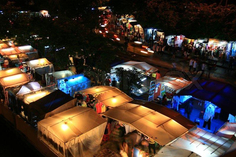 BANGKOK - JULY 3 : Tourists walk in shopping night market ...
