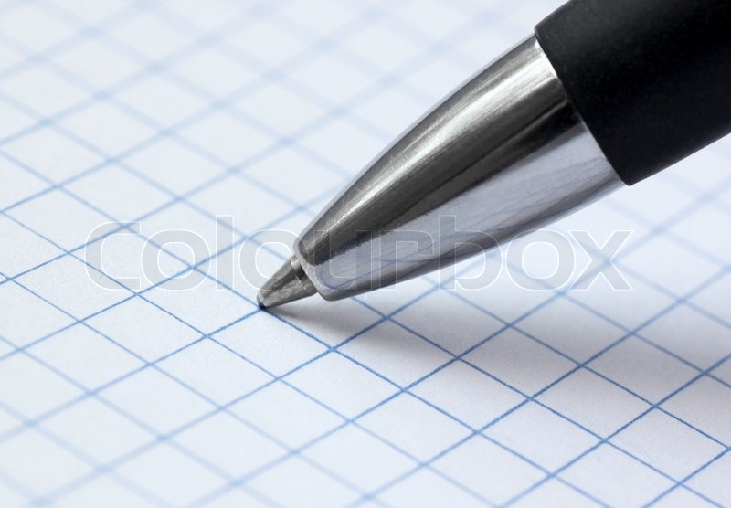 Close up of ballpoint pen at paper, stock photo