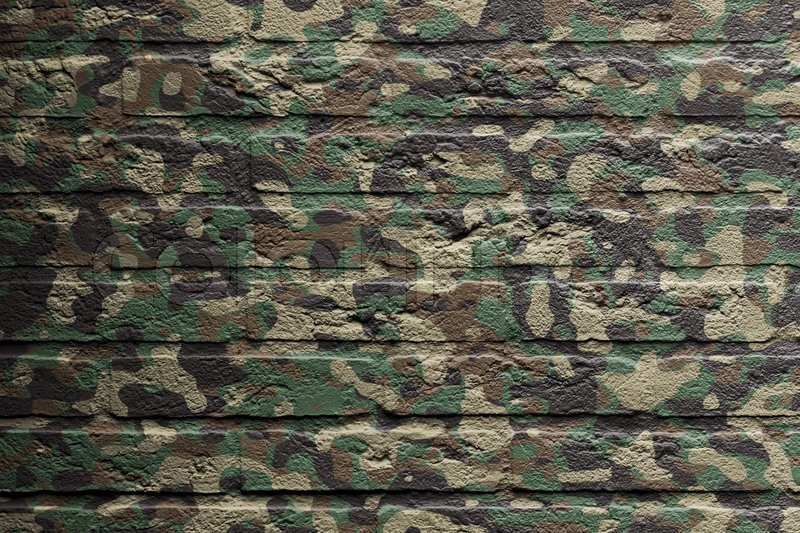 Brick Wall With A Painting Of A Flag Camouflage Stock