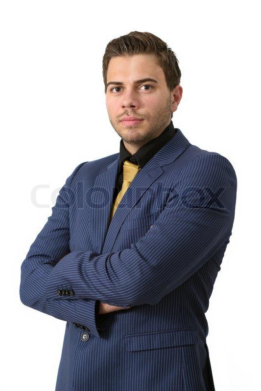 ein junger strenge gesch ftsmann in einem blauen anzug mit einem goldenen krawatte stock foto. Black Bedroom Furniture Sets. Home Design Ideas