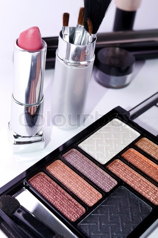 Make-up colorful eyeshadow palettes with makeup brush, stock photo