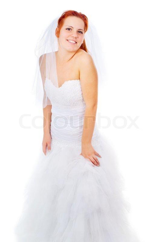 Eine schöne rothaarige Braut weint | Stockfoto | Colourbox