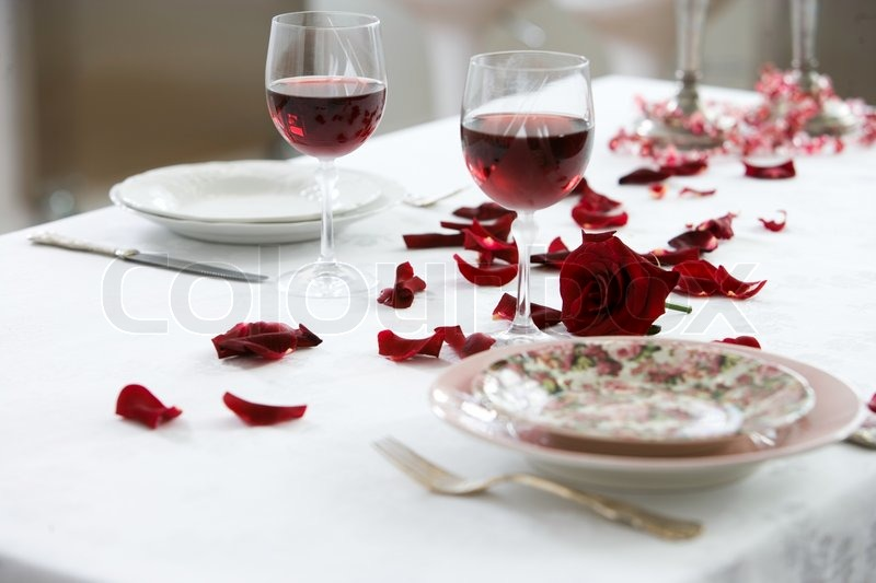 Table Decorated With Rose Petals For A Romantic Dinner