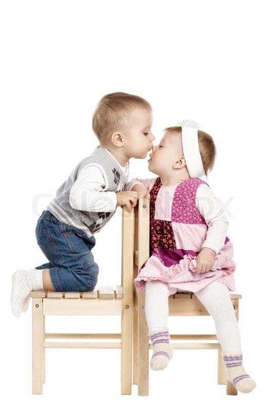 Little Cute Boy Kissing A Girl Stock Photo Colourbox