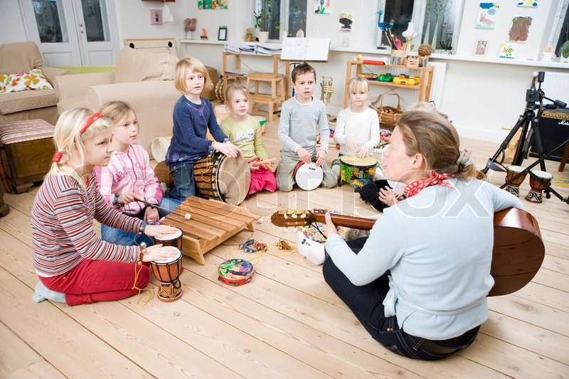 a group of children learning to play musical instruments stock photo colourbox. Black Bedroom Furniture Sets. Home Design Ideas