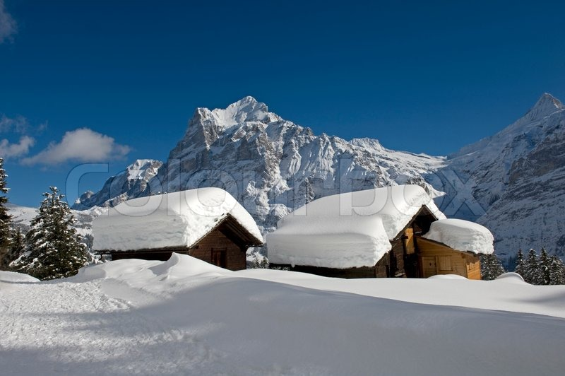 huts and mountain in winter wonderland stock photo colourbox