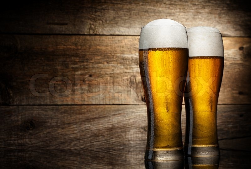 two glass beer on wood background with copyspace stock