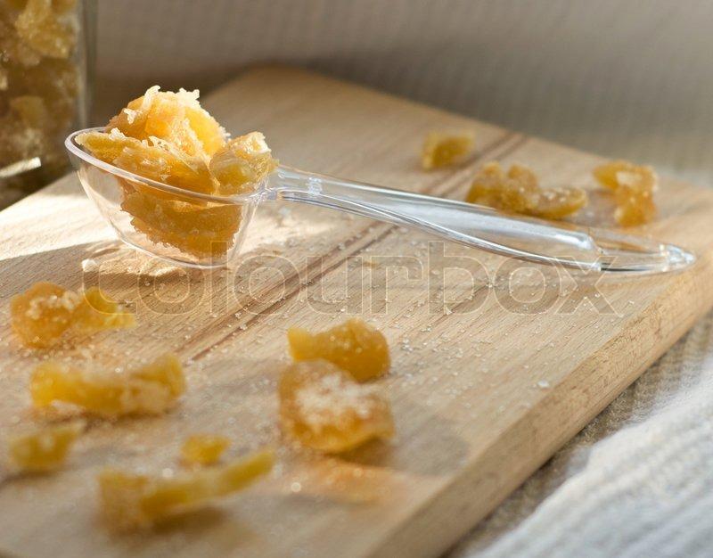 Kandiseret ingefær på træplade | stock foto | Colourbox