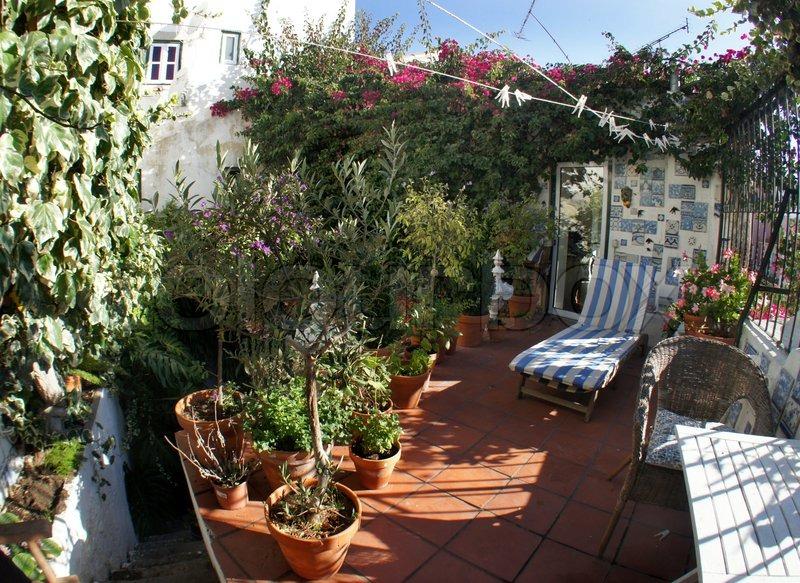 gut gestaltete terrasse mit blumen stockfoto colourbox. Black Bedroom Furniture Sets. Home Design Ideas