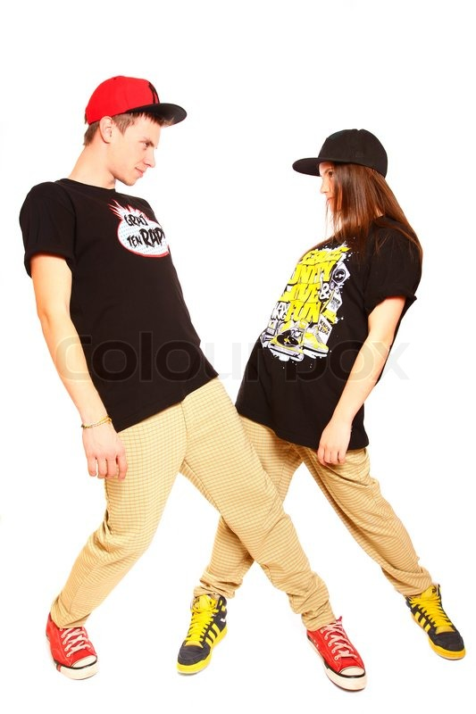 couple of young man and woman dancing hip hop at studio stock