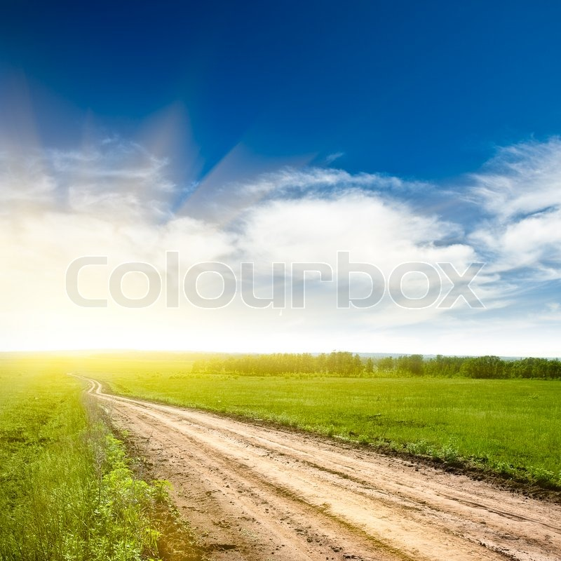 Stock image of 'Rural road to the sun'