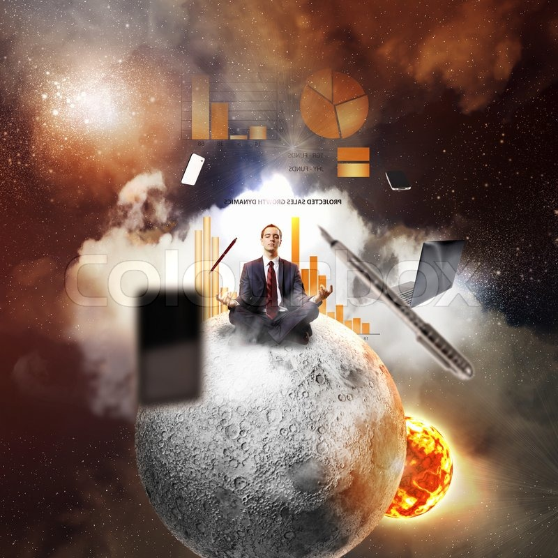Businessman sitting in lotus flower position against space background with office stuff aloft, stock photo