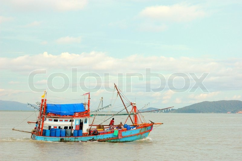The fishing boats go to open sea on sunnyday at Rayong,Thailand, stock photo