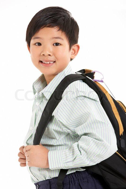 Studio Shot Of Chinese Boy In School Uniform Stock Photo