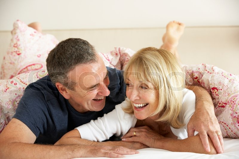 Senior Couple Relaxing Together In Bed  Stock Image -9511