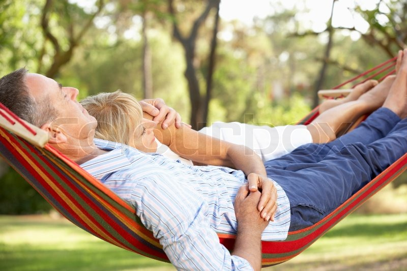 Senior Couple Relaxing In Hammock, stock photo