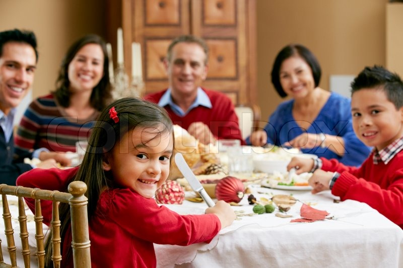 Multi Generation Family Celebrating With Christmas Meal, stock photo