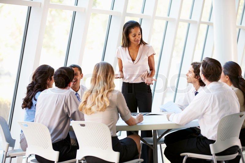 Business People Having Board Meeting In Modern Office, stock photo
