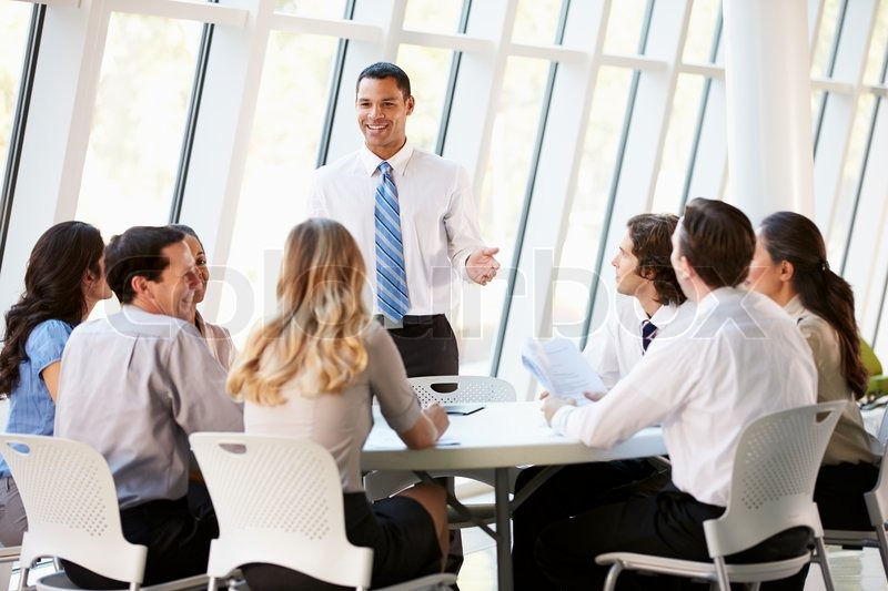 Business People Having Board Meeting In Modern Office, stock photo