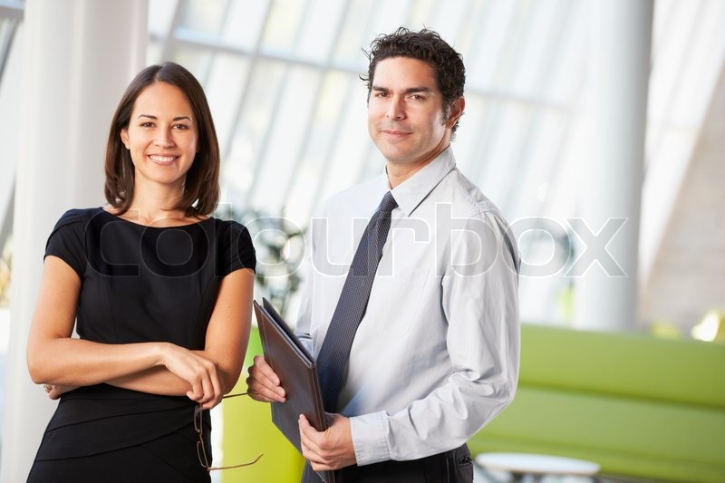 Businessman And Businesswomen Having Meeting In Office, stock photo