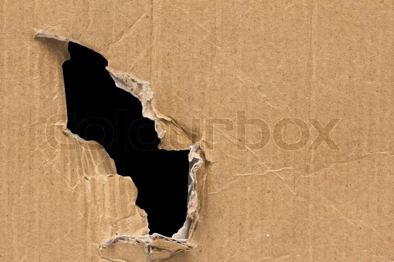 Black hole in a cardboard background, stock photo