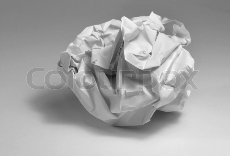 Crumpled paper ball in light grey back, stock photo