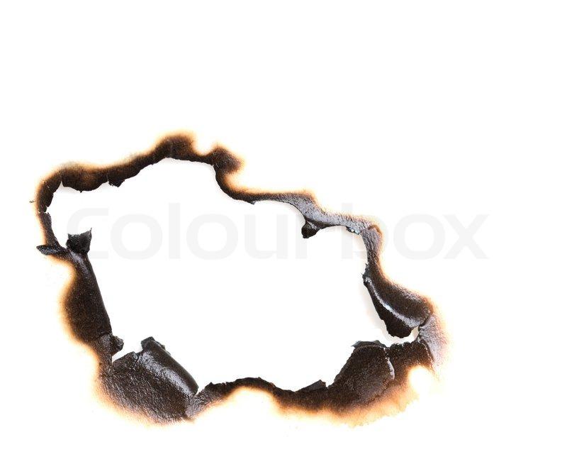 verbrannt loch auf einem wei en papier hintergrund stock foto colourbox. Black Bedroom Furniture Sets. Home Design Ideas