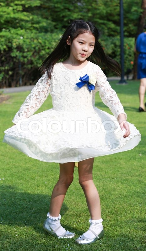 A Cute Little Asian Girl Is Spinning In   Stock Photo  Colourbox-3527