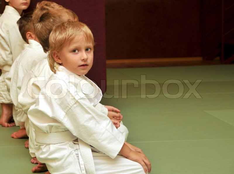 Boys in sport hall, they are waitng for competition, stock photo