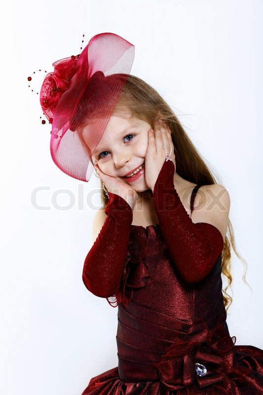 Stock image of 'Little girl in beautiful dress'