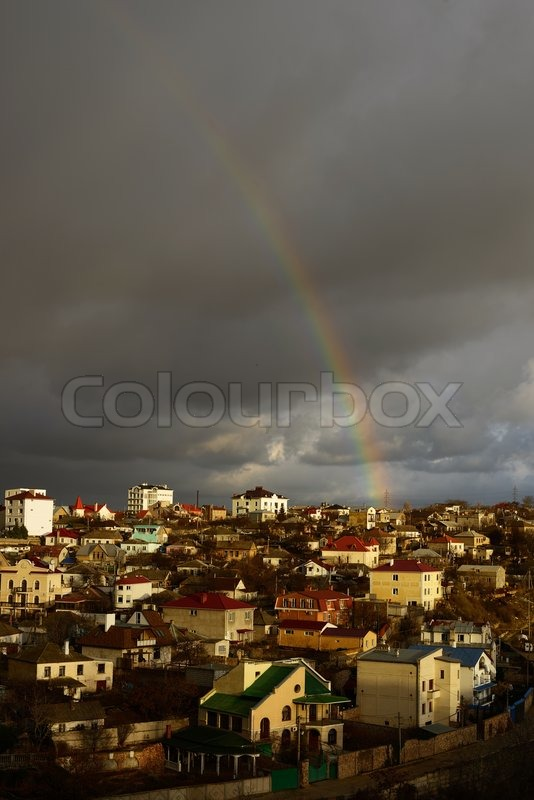Stock image of 'rainbow under the town'