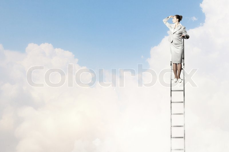 Stock image of 'Businesswoman standing on ladder looking into distance against cloudy background'