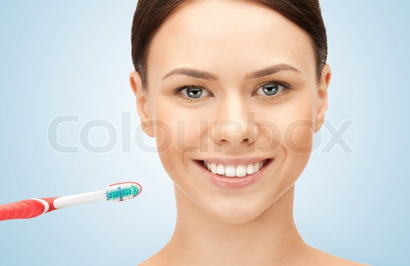Stock image of 'Beautiful woman with toothbrush'