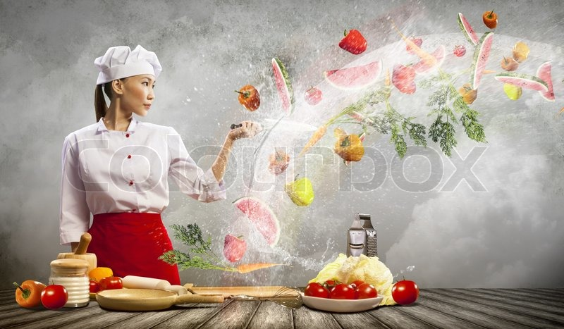 Stock image of 'Asian female cook with knife'